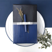 Black and blue reversible gift box with a silver gift ribbon