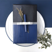 Dark blue and black reversible wrapped gift with a silver gift bow