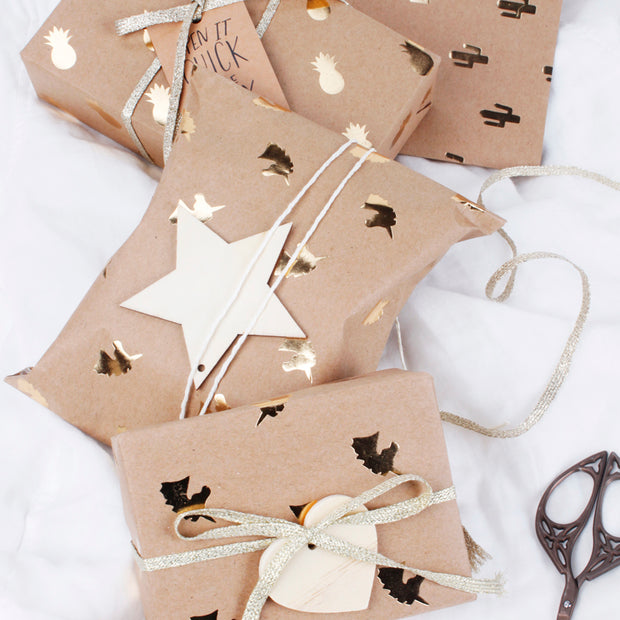 Brown kraft wrapping paper gifts with gold foil print
