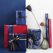 Blue and red metallic gold leaf wrapped gifts