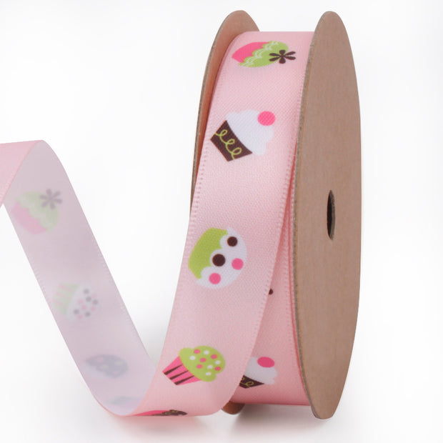 Pink satin ribbon printed with tiny colorful cupcakes