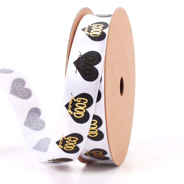 White novelty ribbon printed with gold and black hearts
