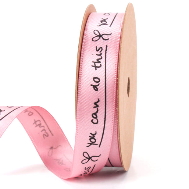 Pink rose satin ribbon with black text