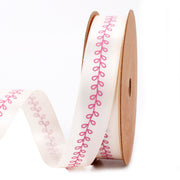 Cream satin ribbon with pink lace print