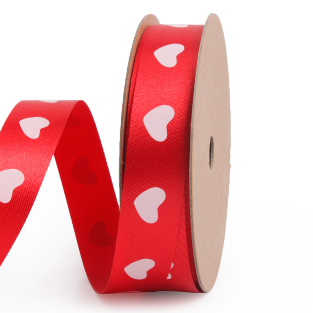 Red satin ribbon printed with mini white hearts