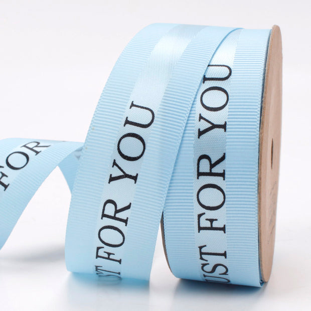 25 millimeter blue topaz satin ribbon printed with just for you text
