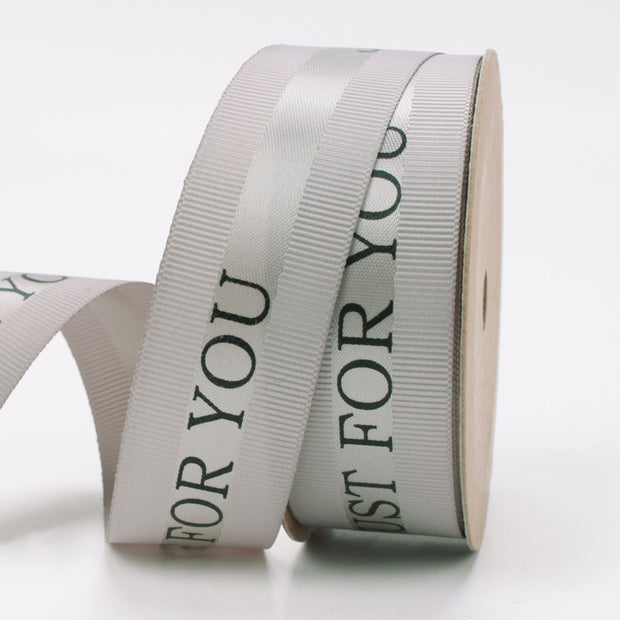 25 millimeter silver satin ribbon printed with just for you text
