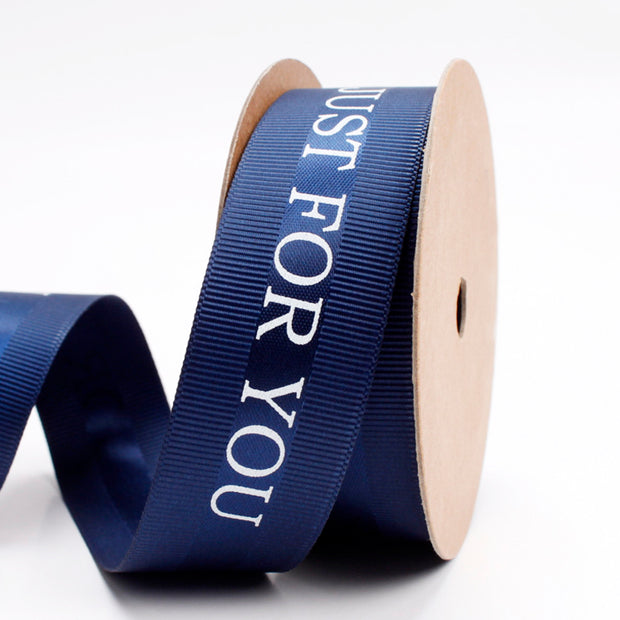 25 millimeter navy blue satin ribbon printed with just for you text
