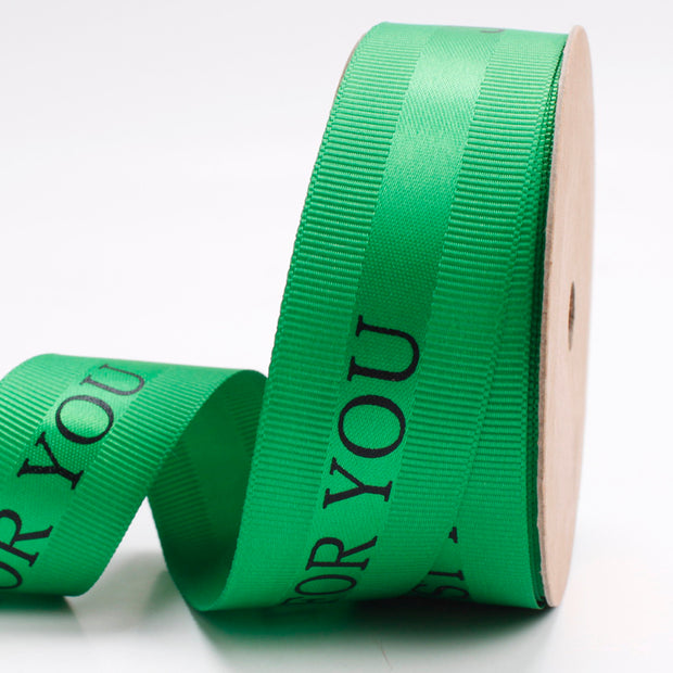 25 millimeter green satin ribbon printed with just for you text