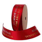 25 millimeter red, gold and silver text printed satin ribbon