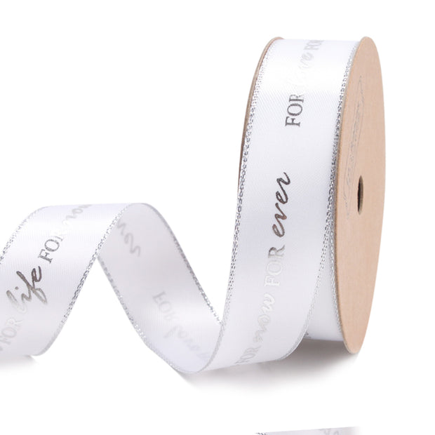 22 millimeter white and silver text printed metallic satin ribbon