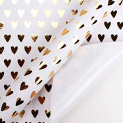 White and gold foil heart wrapping paper roll