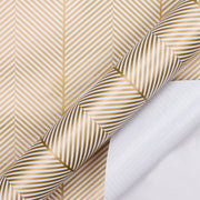 White and gold herringbone pattern wrapping paper roll