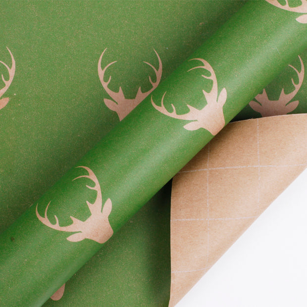 Green and beige reindeer kraft gift wrapping paper roll