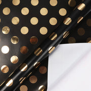 Black and gold polka dot print metallic foil wrapping paper roll