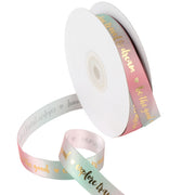 Green and pink gradient ribbon printed with gold text