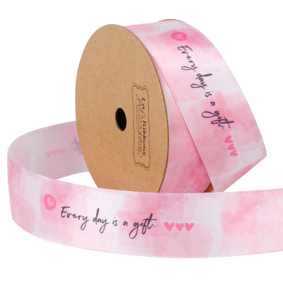 25 millimeter pink satin ribbon printed with text