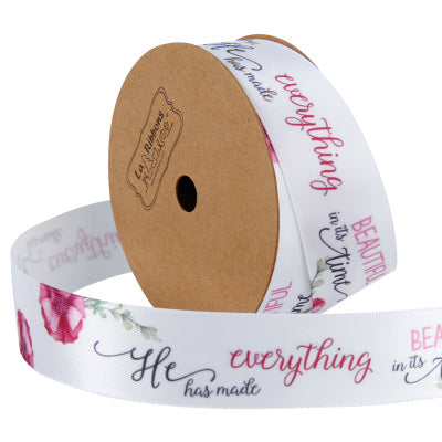 25 millimeter white satin ribbon printed with script text
