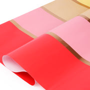 Pink, red and yellow stripe wrapping paper roll