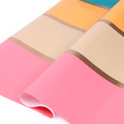 Pink, yellow, beige and turquoise stripe wrapping paper roll