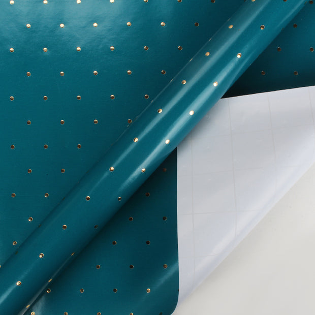 Teal and gold metallic foil polka dot printed wrapping paper roll