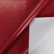 Red and gold foil stripe wrapping paper roll
