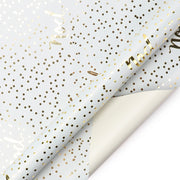 White and metallic gold polka dot wrapping paper roll with text