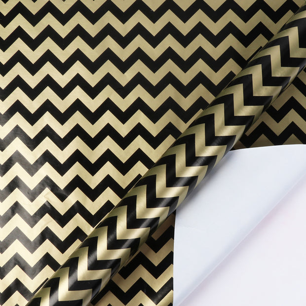 Black and gold metallic chevron wrapping paper roll