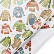 White wrapping paper roll printed with ugly Christmas sweaters