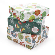 Stack of green and white ugly Christmas sweater printed wrapped gifts