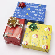 Red, yellow and blue gift boxes wrapped with green, gold and red gift bows