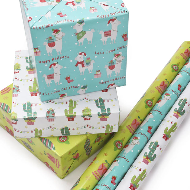 Stack of cactus theme wrapped gifts next to wrapping paper rolls
