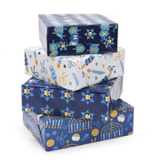 Stack of blue and white Hanukkah theme wrapped gifts