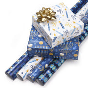 White and blue Hanukkah printed wrapped gifts and wrapping paper rolls