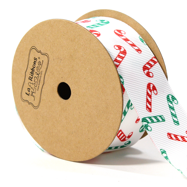 1 1/2 inch white Christmas theme ribbon with green and red candy canes
