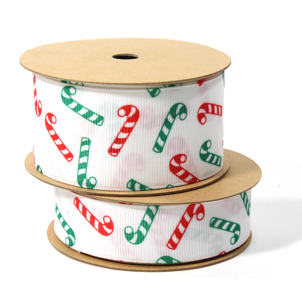 White Christmas ribbons with green and red candy cane spools