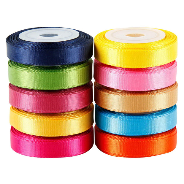 Stack of multi color assorted satin ribbon spools