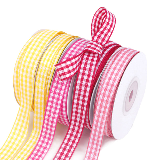 Pink and yellow gingham printed ribbon spools