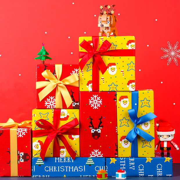 Stack of yellow, red and blue Christmas retro pixel theme wrapped gifts