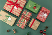 Collection of green and red kraft gift boxes, wrapped with red gift bows