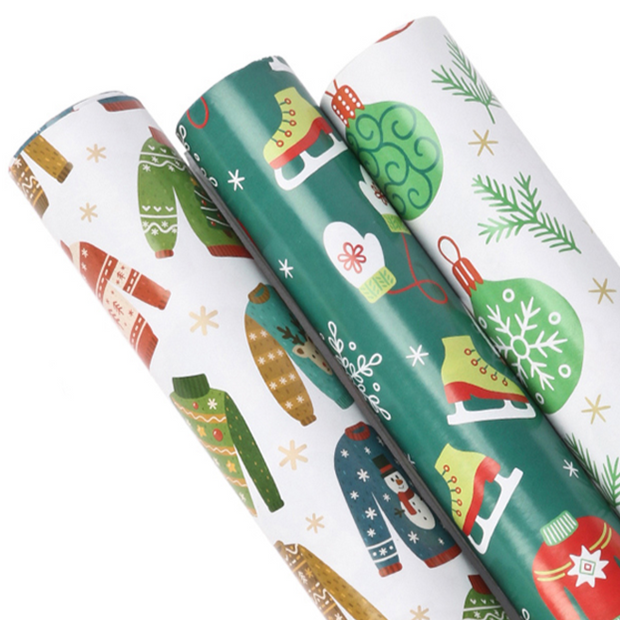 White and green ugly Christmas sweater theme wrapping paper three roll pack