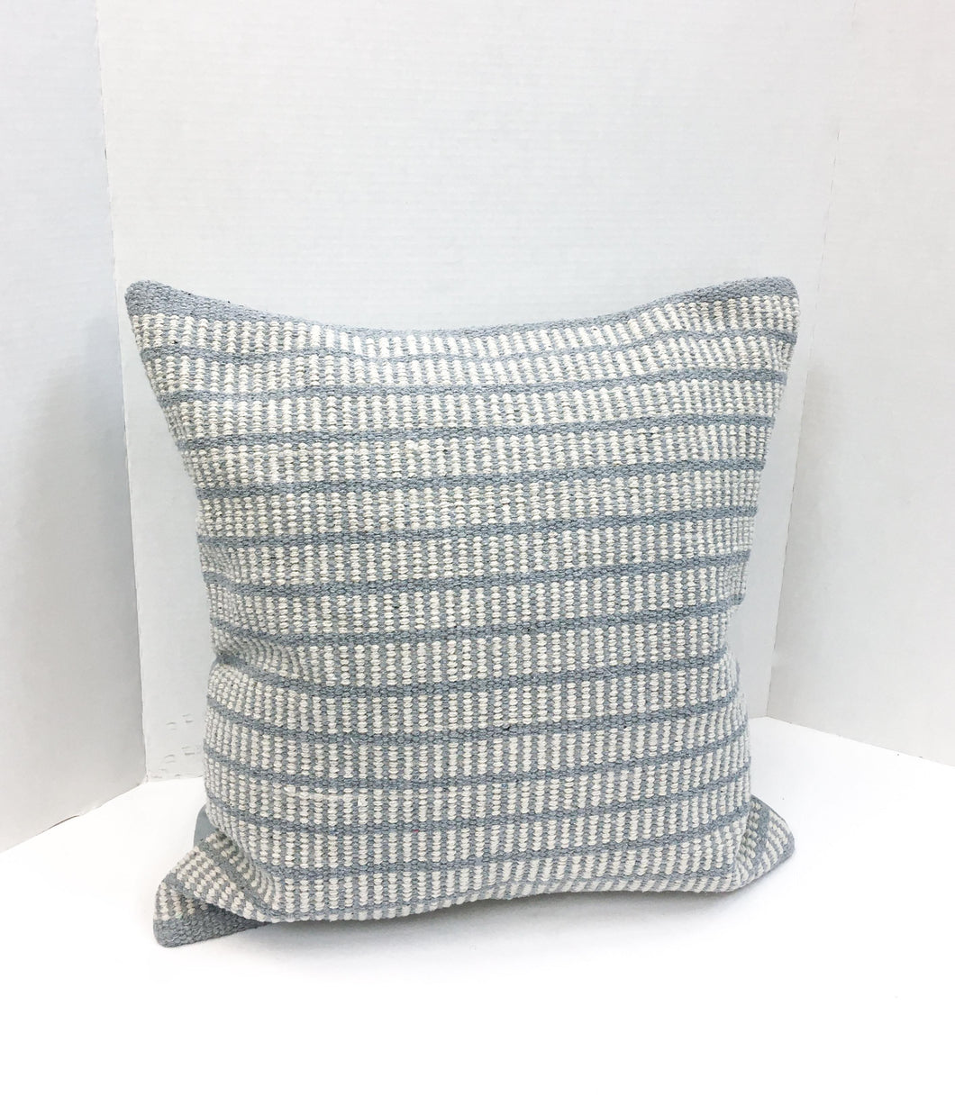 Natural Over Soft Blue Textured Pillow