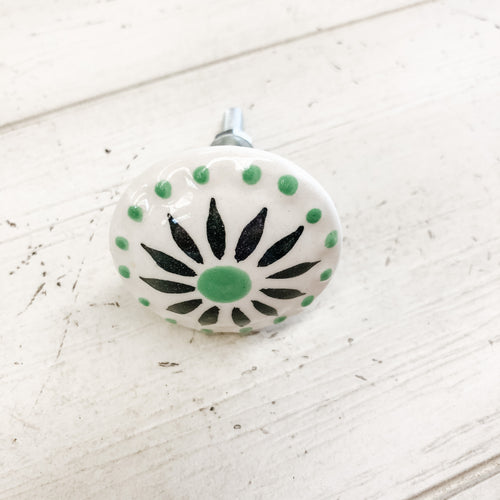 Ceramic Knob Green and Black Sun Burst over white
