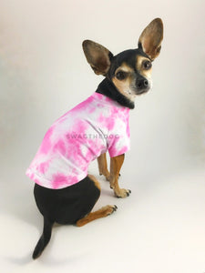 Swagadelic Pink Tie Dye Tee - Cute Chihuahua named Hugo in sitting position with his back towards the camera and looking back, wearing the hand tie-dyed tee with Pink
