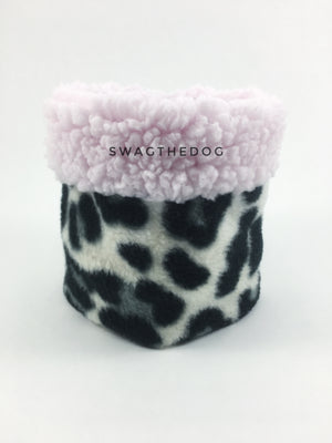 Gray Snow Leopard Swagsnood - Product Front View. Pink sherpa rolled up 1/3 of the snood and 2/3 with gray snow leopard print fleece