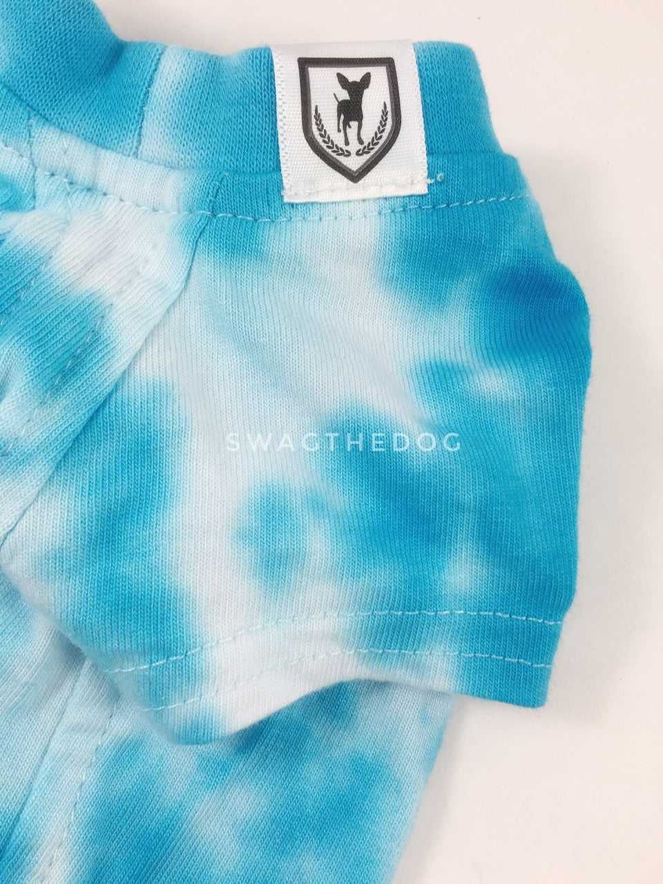 Swagadelic Sky Blue Tie Dye Tee - Close-up of product front view. The hand tie-dyed tee with Sky Blue