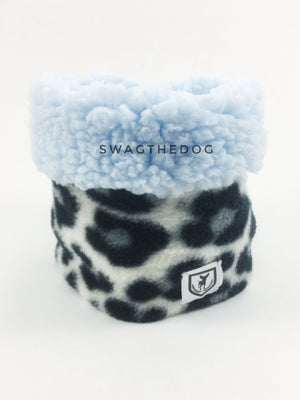 Gray Snow Leopard Swagsnood - Product Front View. Blue sherpa rolled up 1/3 of the snood and 2/3 with gray snow leopard print fleece