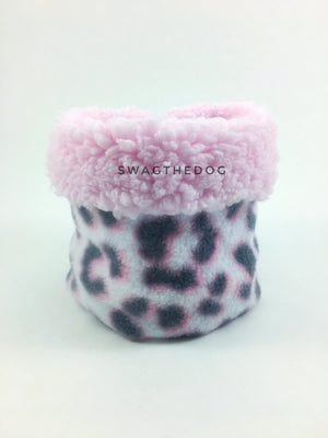 Pink Snow Leopard Swagsnood - Product Front View. Pink sherpa rolled up 1/3 of the snood and 2/3 with pink snow leopard print fleece