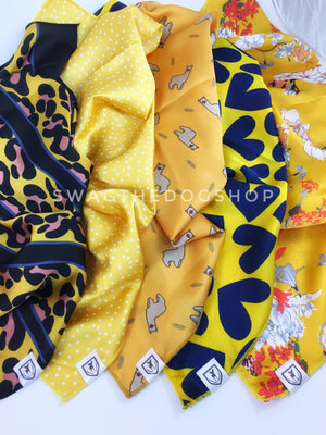 Take an advantage of 3 for $30. 5 Yellow Color Theme Swagdana Scarves Displayed. 1-Leopard Sunflower Yellow. 3-Polka Itty Bitty Sunny Yellow. 3-Lorenzo Llama Yellow. 4-Full of Heart Royal Yellow. 5-Yellow Wild Flower. Dog Bandana. Dog Scarf.
