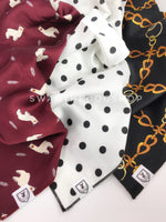 Take an advantage of 3 for $30 deal. 3 Red/White/Black color theme Swagdana Scarves displayed. 1-Lorenzo Llama Burgundy. 2-Polka Dot White. 3-24K Black Gold. Dog Bandana. Dog Scarf